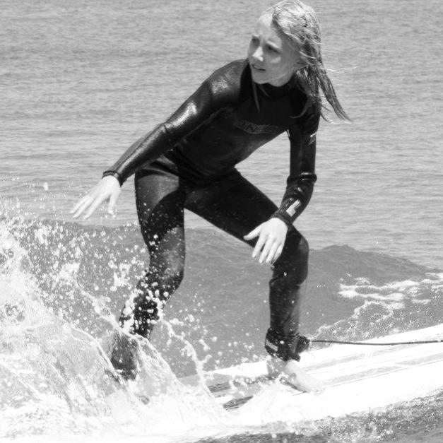 Madisyn surfing New Hampshire