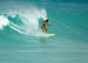 Barbados babe (aka Melanie) enjoying a fine looking wave - Photo by Barbados Surf Trips