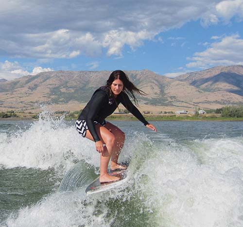 Gina Duffy surfing a 'boat wave'